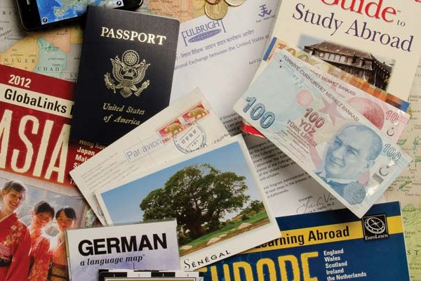 world map, passports, and currency