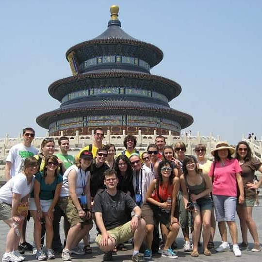 Faulds' group in China at a monument