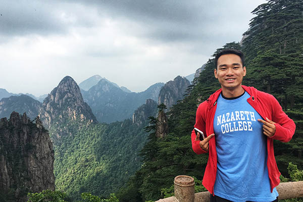 Leo Wu '19G in Nazareth T-shirt on Yellow Mountain, eastern China