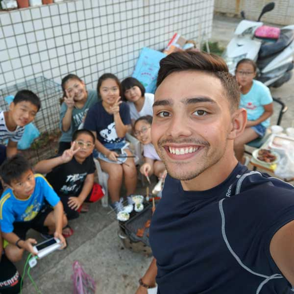 Shane Fuentes with sixth-graders in Taiwan