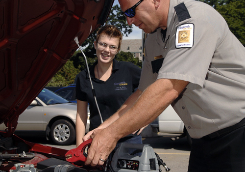 campus safety officer jump start car