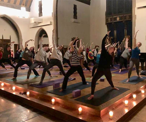 night light yoga class by candlelight