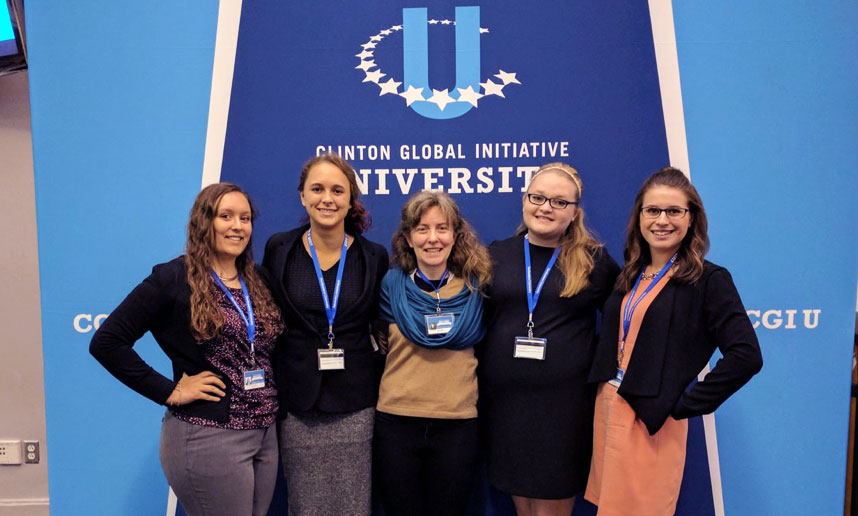 Jennifer Leigh with students at CGIU