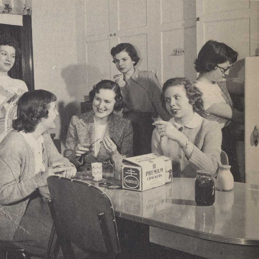 1950s students snacking in a dorm