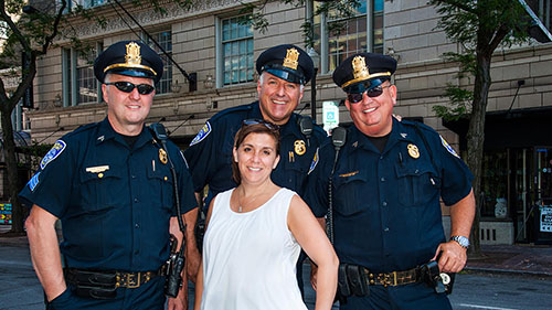 Jenna Knauf with uniformed police officers at Rochester Jazz Fest