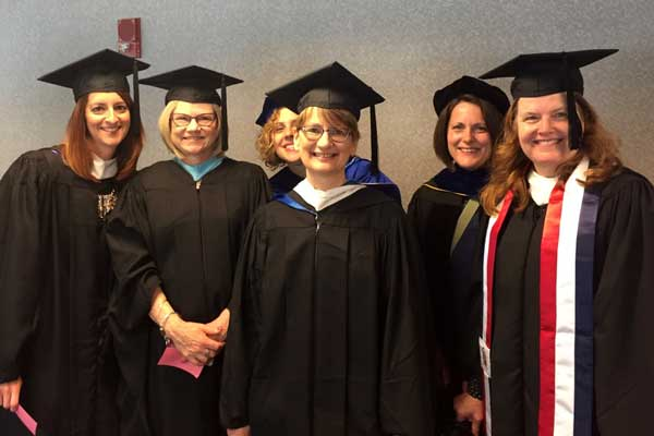 Kristin with CSD faculty, commencement 2018