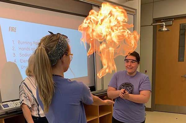 Meredith with a fireball in the air, demonstrating flammable gases