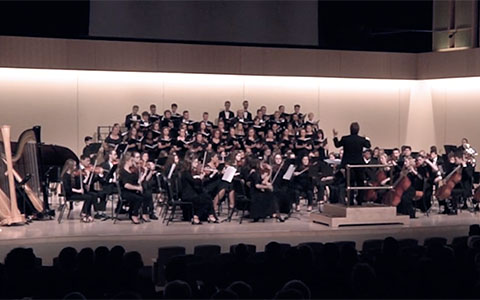 Student musicians and singers performing onstage in Glazer Music Performance Center