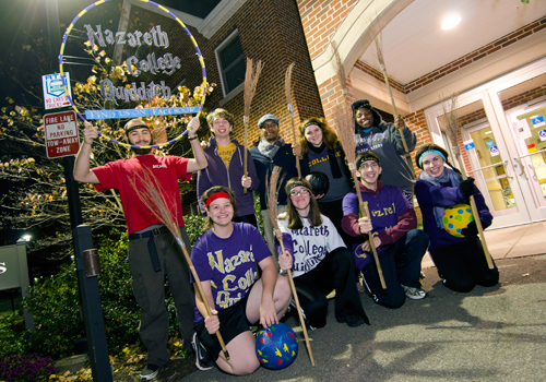 Quidditch team in front of Lyons residence hall